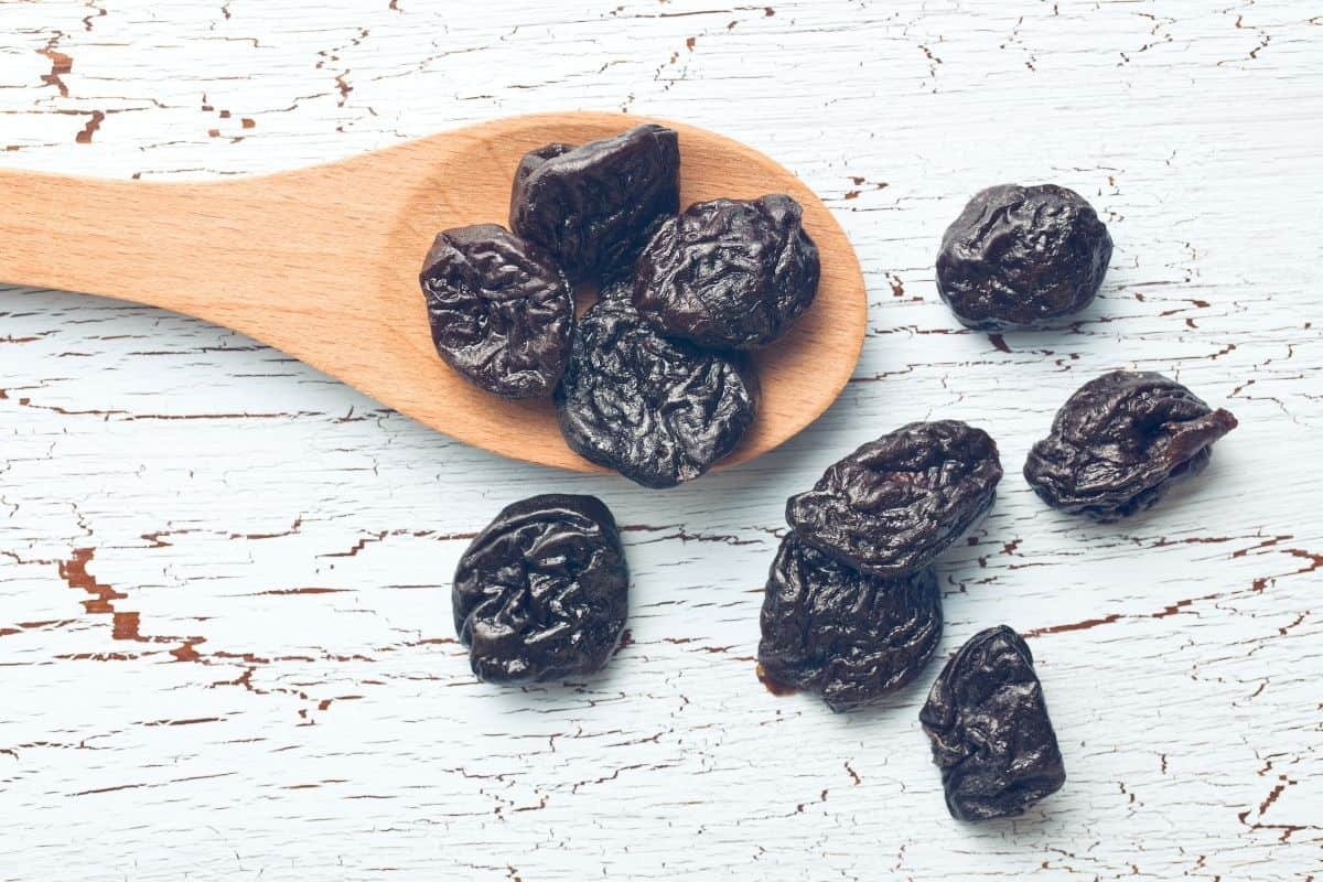 Prunes and a wooden spoon